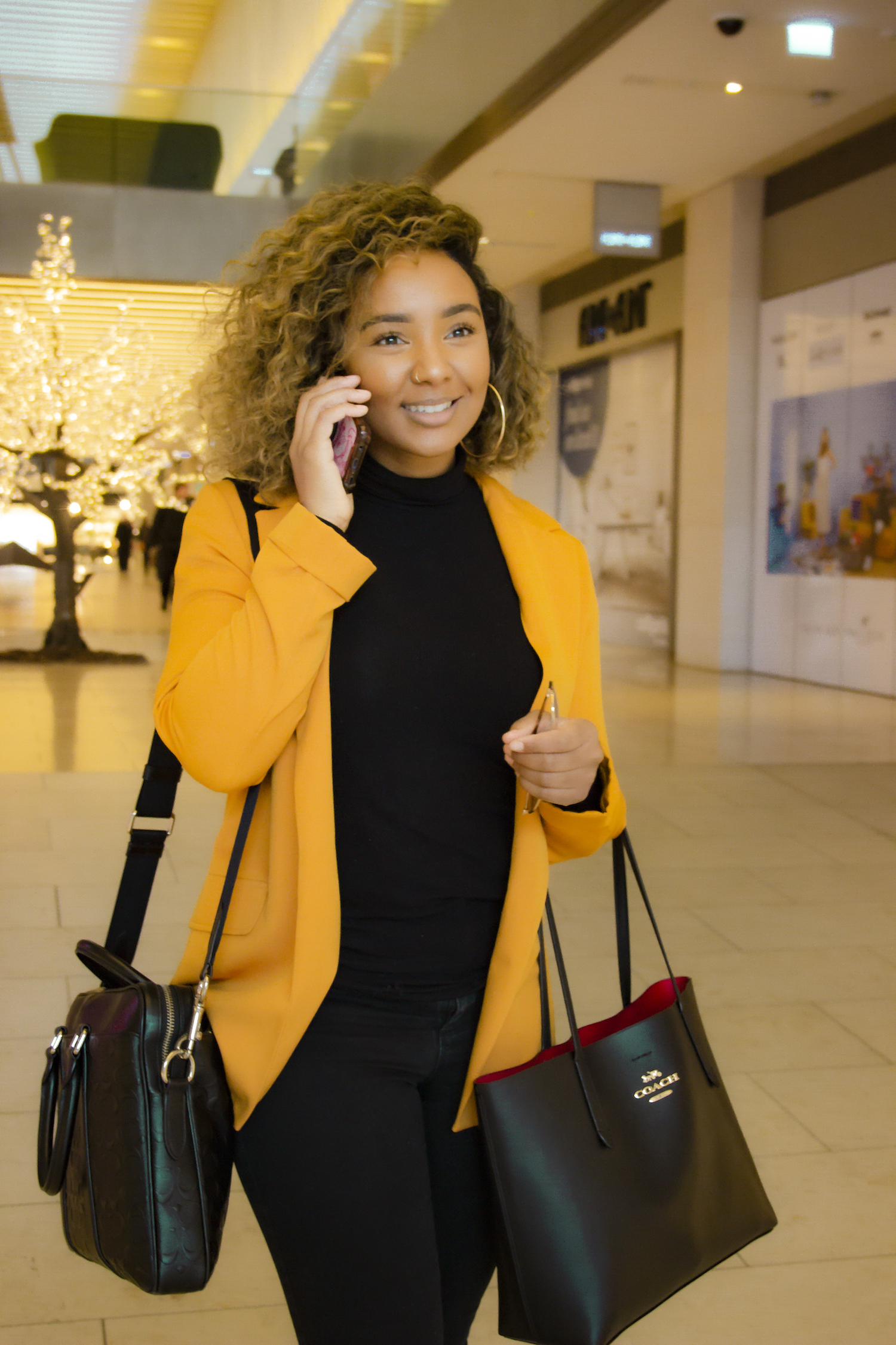 Lianne Digital Marketing Consultant walking and talking on the phone